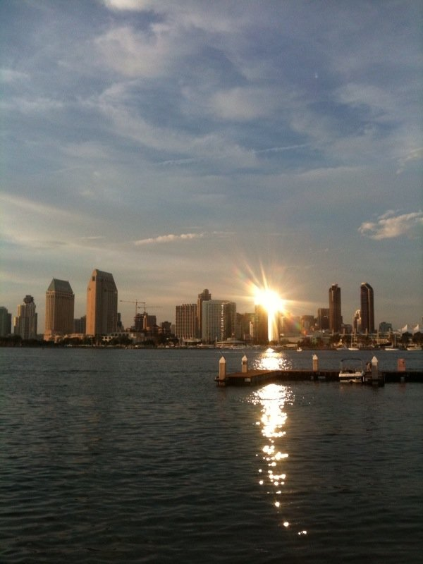 View of Downtown San Diego from Coronado Ferry Landing with sunset reflecting off Marriott Hotel at the Marina.