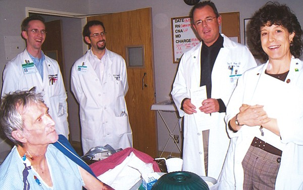 Michael McCrerey (seated) at Scripps Green hospital one week after his 