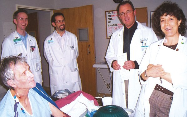 Michael McCrerey (seated) at Scripps Green hospital one week after his  liver transplant. Dr. Randy Schaffer (third from right) was the lead surgeon.  Dr. Christopher Marsh (second from right), head of organ and cell  transplants, went to Chula Vista to pick up Mario Pinedo's donated liver.