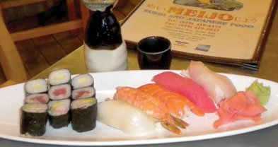 The sushi mix: five kinds of fish flesh on rice, plus nine pieces of sushi rolls