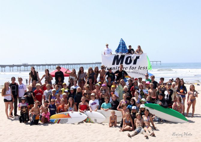 Local surf contest open for ages 16 and under (2011 Gromfest).  Group photo of contestants