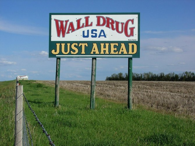 Up ahead: another sign for Wall Drug
