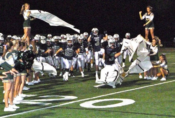 La Costa Canyon players break through the banner after halftime