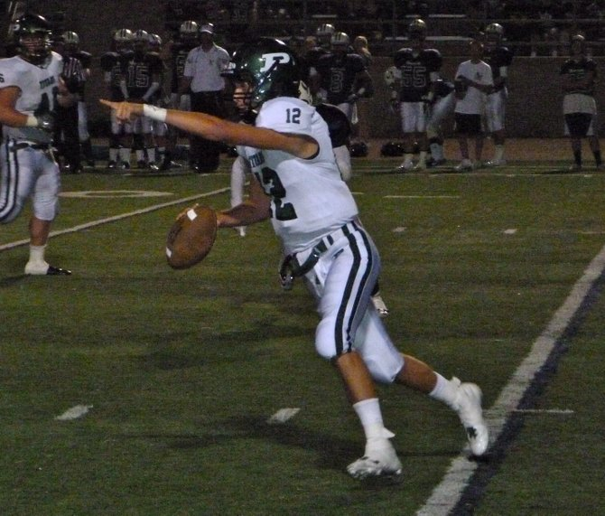 Poway quarterback Gabriel Isaak motions to a teammate downfield