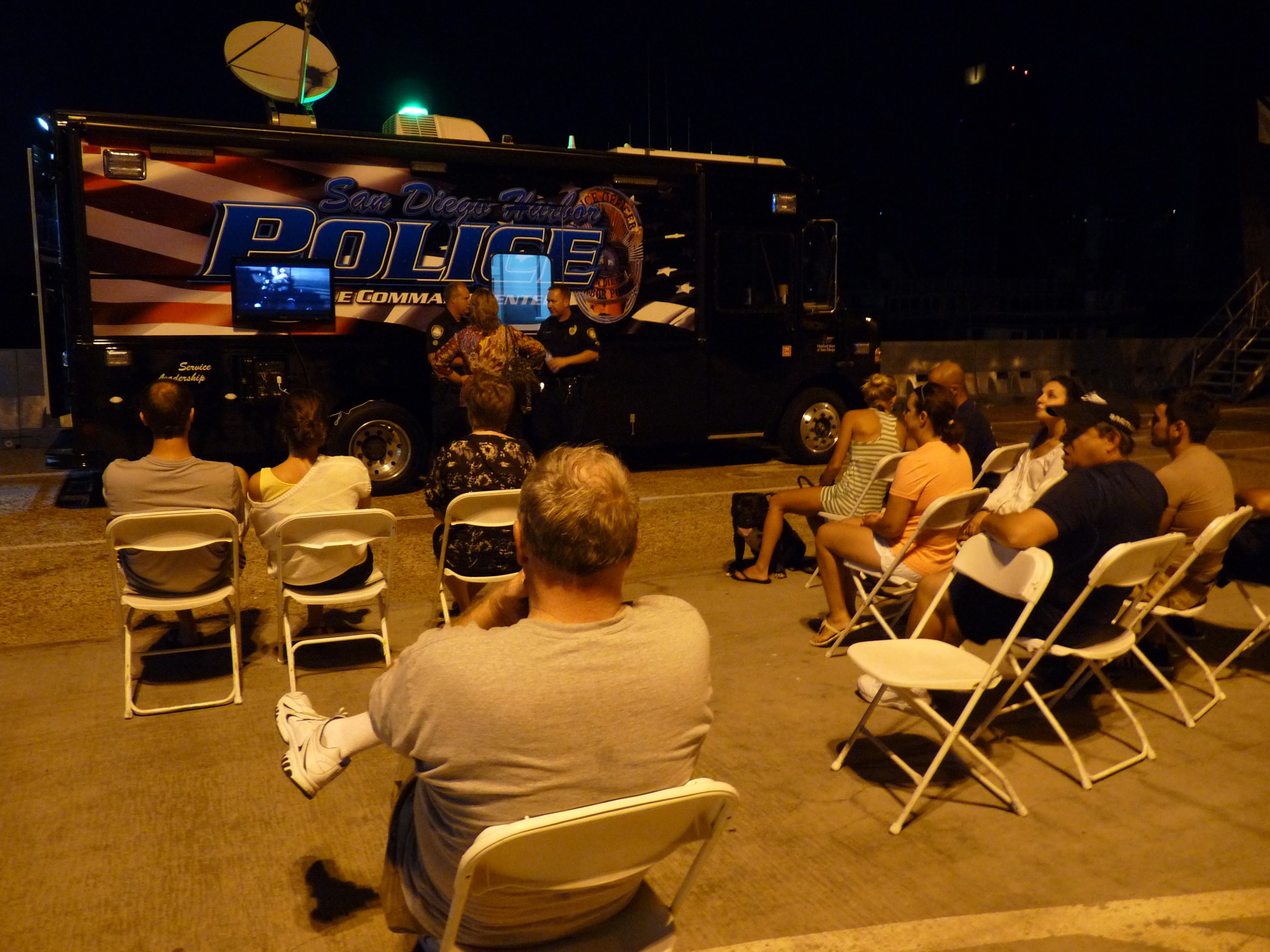 This was at the Broadway Pier during the blackout. People watched the big football game on the police truck. September 8, 2011