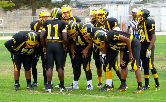 Mission Bay quarterback Nate Long calls out a play in the offensive huddle