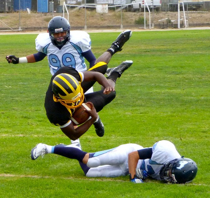 Mission Bay quarterback Nate Long flies forward for extra yards over Otay Ranch defensive back Jordan Peterson