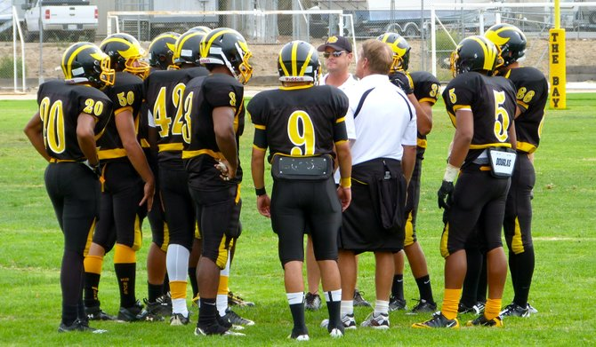 Mission Bay's defense listens to head coach Willie Matson during a timeout