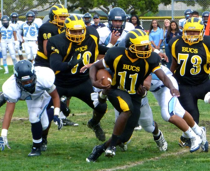 Mission Bay quarterback Nate Long runs the ball outside
