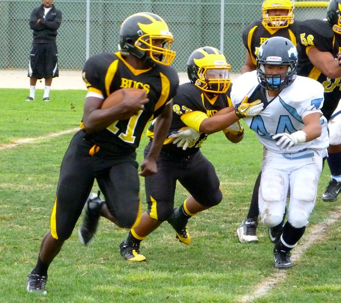 Mission Bay quarterback Nate Long turns the corner in front of Otay Ranch linebacker Justin Doton