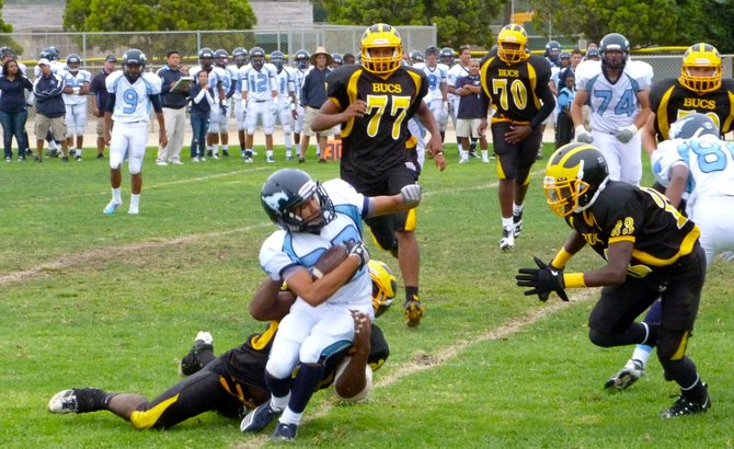 Otay Ranch running back Andrew Jones pulled down from behind by Mission Bay linebacker Isaac Griffin