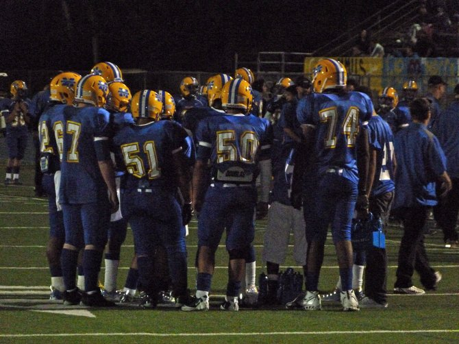 Mira Mesa's offense huddles up during a timeout