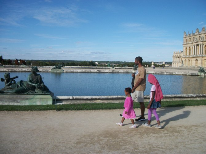 My husband and two daughters hanging out behind the Versailles Castle, near Paris. The castle was closed so we enjoyed the beautiful garden and ponds.