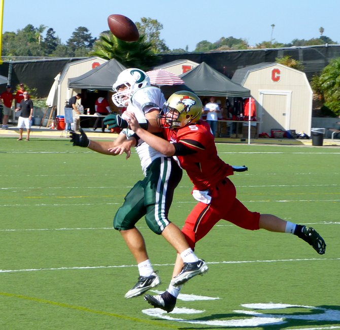 Santa Fe Christian safety Connor Moore knocks the ball loose from Coronado tight end Jack Perkins