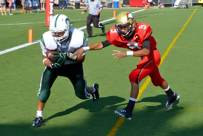 Coronado tight end Hunter Corpus hauls in a touchdown pass in front of Santa Fe Christian defensive back Andrew Barajas