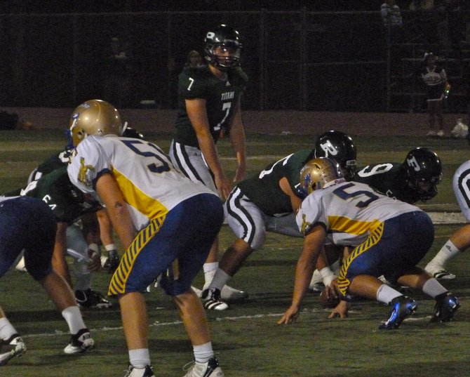 Poway quarterback Conor Flanagan surveys the San Pasqual defense