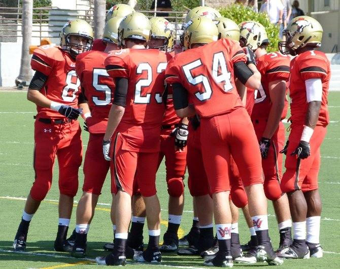 Santa Fe Christian in the offensive huddle