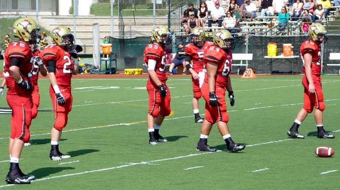 Santa Fe Christian's defensive front waits for the snap
