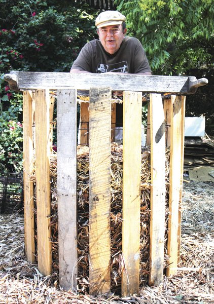 Charles Anacker, a furniture designer,  with his homemade composter