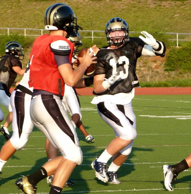 Westview senior Taylor McNamara rushes the quarterback during a Wolverines practice