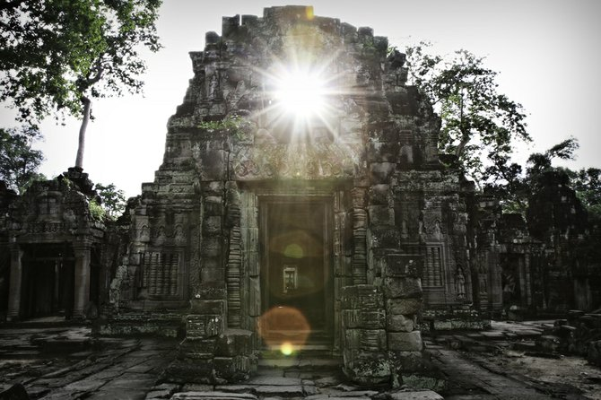Angkor Wat. In one of the less-traveled temples, this ray of sunlight caught my attention after the pounding rain I'd experienced the previous several days.