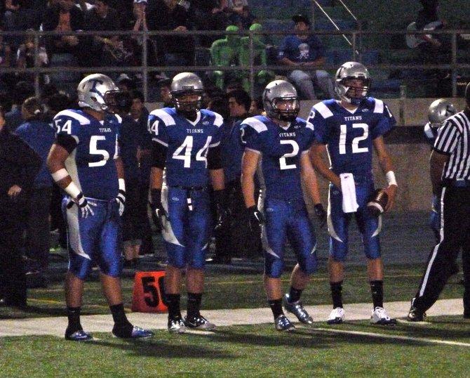 Eastlake team captains on the Titans sideline