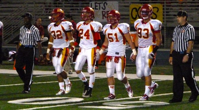 Cathedral Catholic team captains walk out to midfield for the coin toss