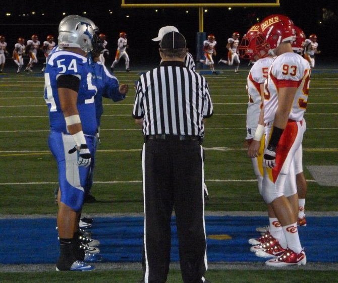 Eastlake and Cathedral Catholic team captains meet for the coin toss