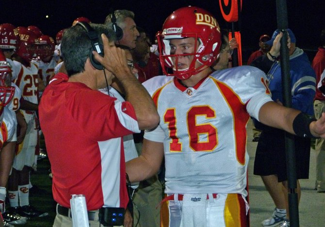 Cathedral Catholic quarterback Garrett Bogart talks things over with Dons head coach Sean Doyle