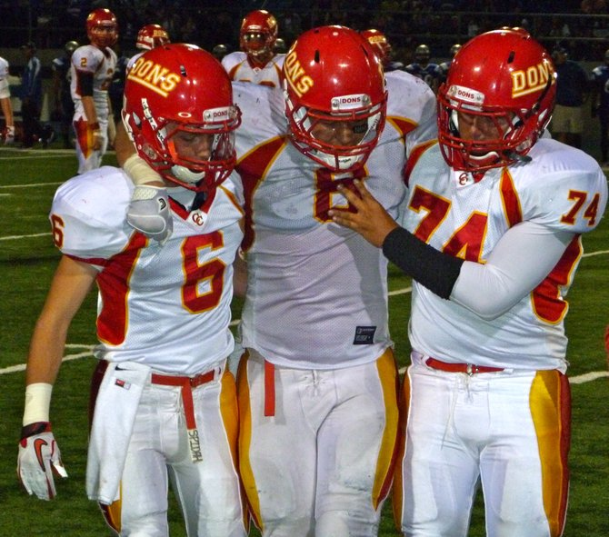 Cathedral Catholic defensive back Alex Edwards-Johnson (6) and lineman Mason Segura (74) help injured teammate Toshaun Poumele off the field