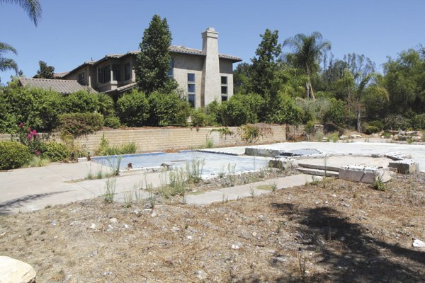 The empty lot of the arsoned Mt. Woodson home today.  The next door neighbor's home also suffered $125,000 in damages.
