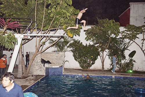High-dive board over a near-Olympic-size pool