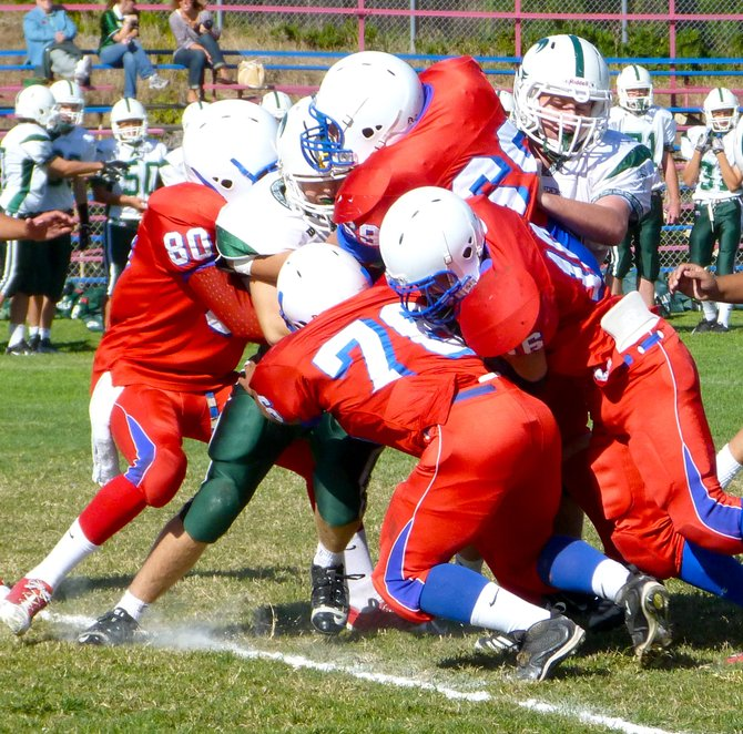 A stable of Crawford Colts defenders wrap up Coronado running back Jake Shephard