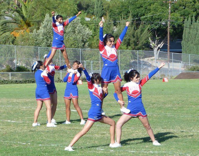 Crawford cheerleaders perform during halftime