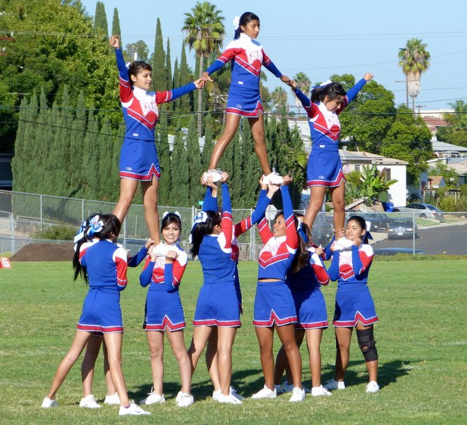 Crawford cheerleaders wrap up their halftime performance with a stack