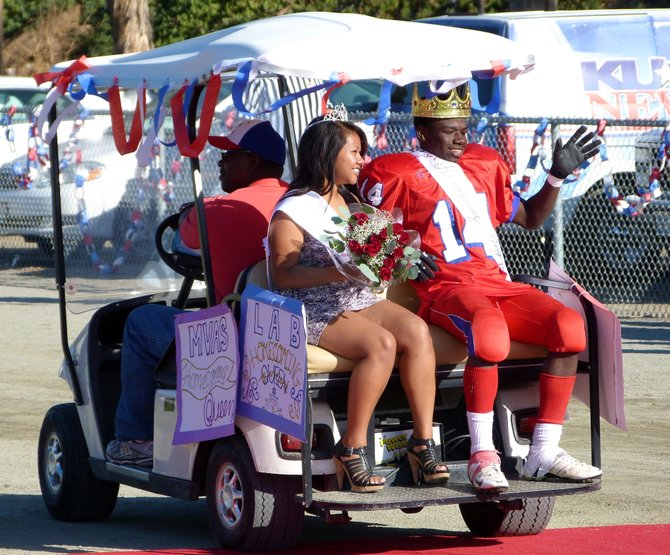 Crawford's Homecoming king and queen receive the royal golf cart treatment after being crowned