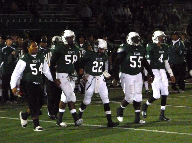 Helix captains walk onto the field for the coin toss