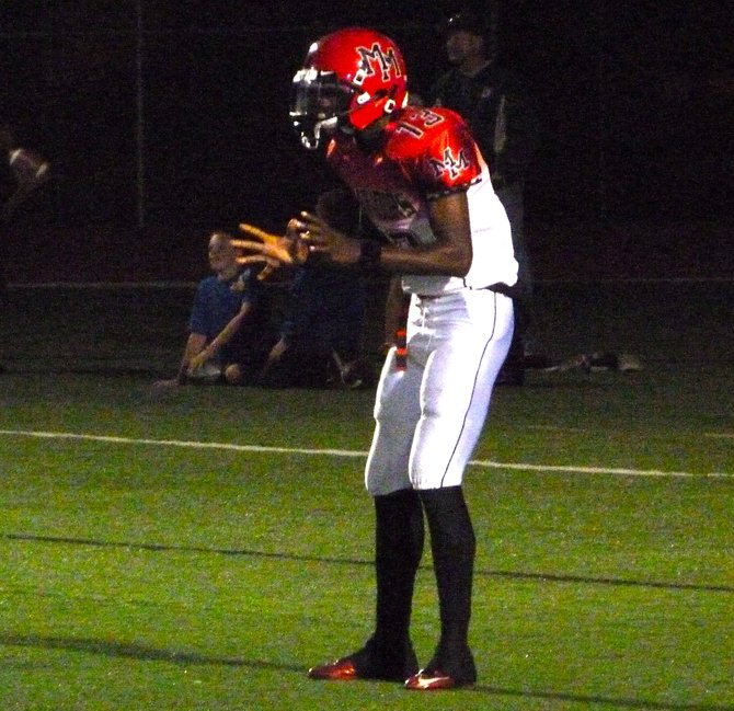 Mount Miguel quarterback Ernest Williams calls for the shotgun snap