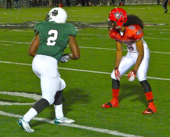 Helix receiver Tyree Hunter lines up across from defensive back Javon Gauthier