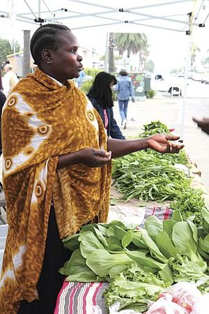 Uganda native Luchia Lokonyen sells spinach and collard greens each Saturday at the City Heights Farmers' Market