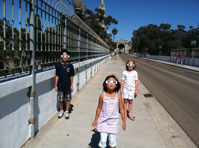 After spending the day at the Aerospace Museum in Balboa Park, this picture was taken walking across the bridge the kids still wearing their 3D glasses.  Emma, Mason and Julie had just watched the movies Flying to the Moon, and Jetpack Adventure in the Aerospace Museum.