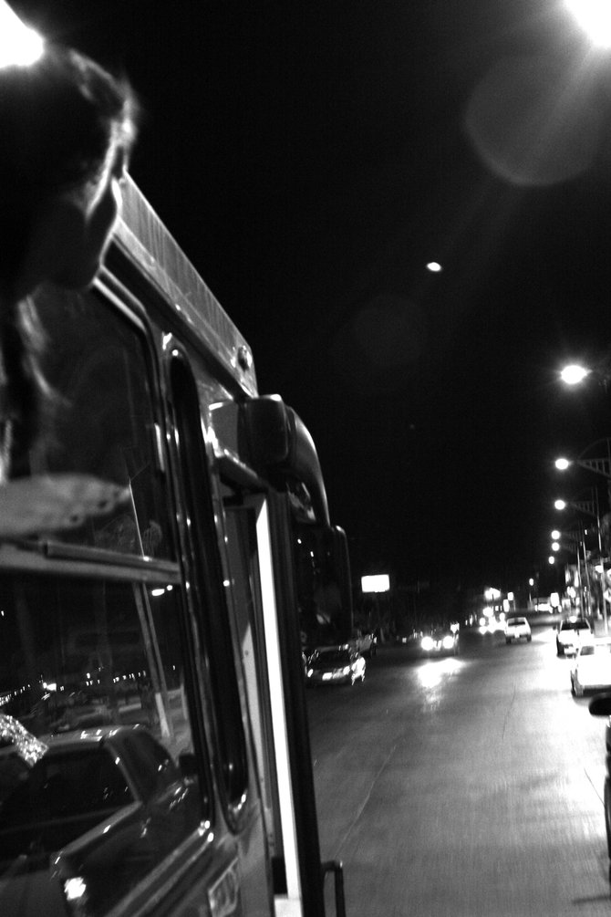 Riding on  a city bus in La Paz Mexico  at night.