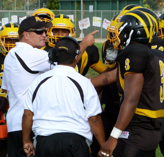 Mission Bay head coach Willie Matson addresses the Buccaneers during a timeout