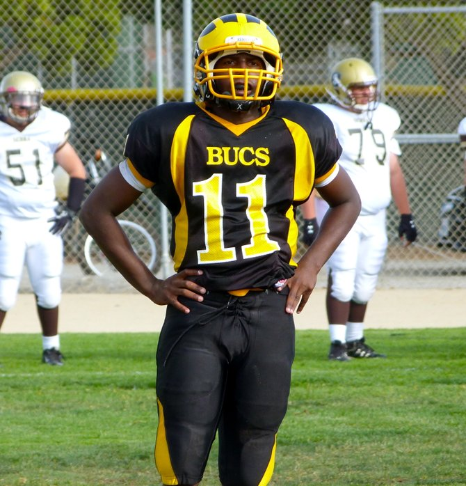 Mission Bay quarterback Nate Long looks to the Buccaneers sideline