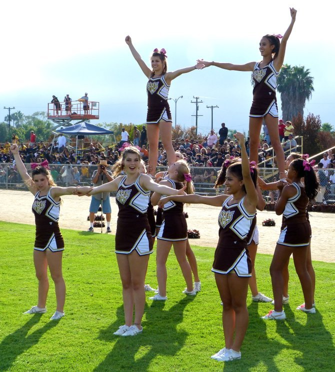Serra cheerleaders celebrate a Conquistadors touchdown