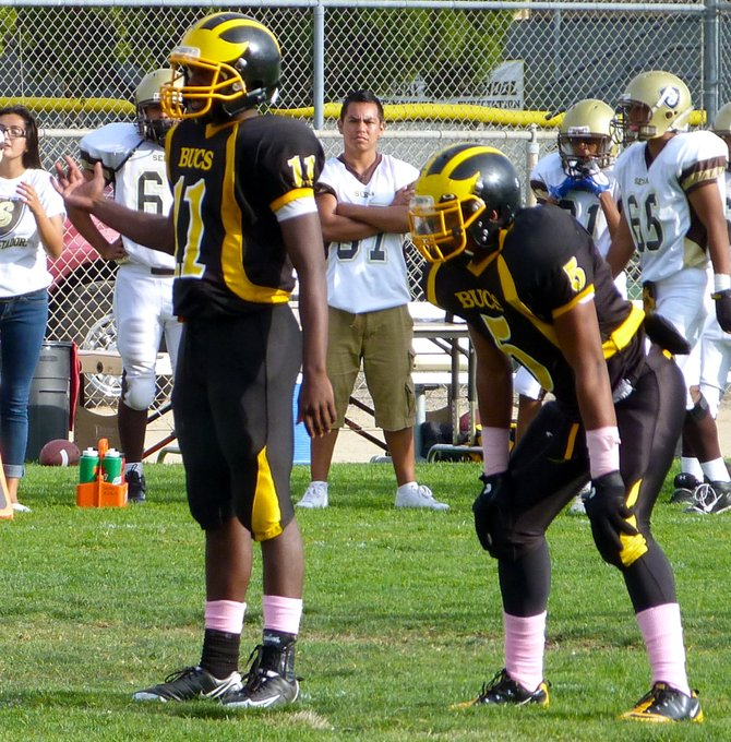 Mission Bay quarterback Nate Long (11) and running back James Phillips (5) in the backfield