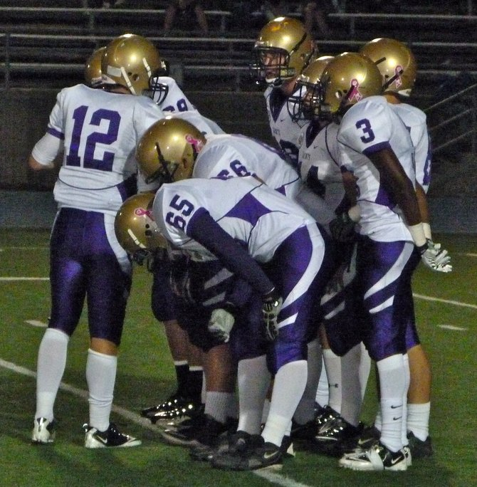 St. Augustine in the offensive huddle