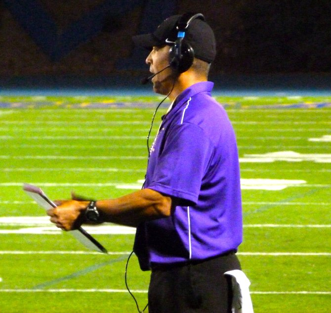 St. Augustine head coach Richard Sanchez shouts instruction at the Saints from the sideline
