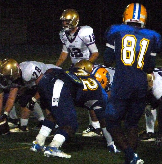 St. Augustine quarterback Joe Kennedy surveys the Mira Mesa defense before getting under center