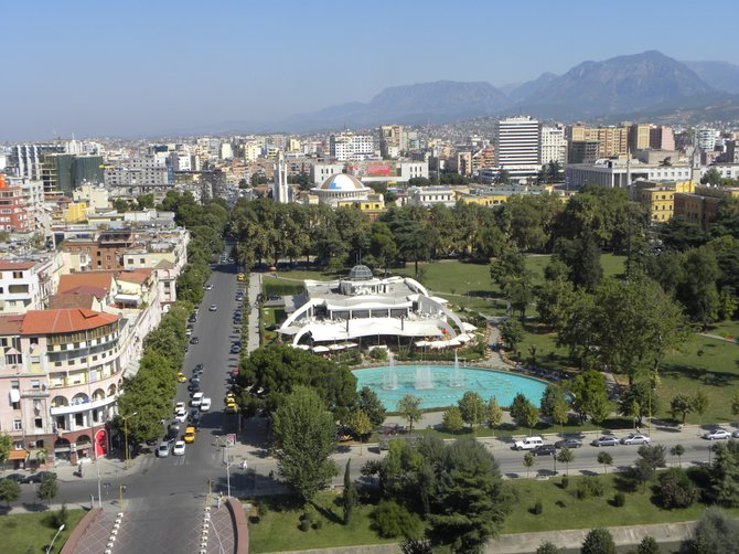 View of Tirana, Albania with the Taiwan Complex in the middle.  Commissioned by Communist leader Enver Hoxha after he broke ties with the Chinese government, today it's where rich Albanians go 'to be seen'.  (There are a bevy of posh restaurants, cafes, and shops inside.)